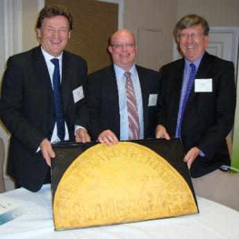Chair of the CDFA, Jonathan Diggines, Richard Wilcox, Managing Director of Unity Trust Bank, and Steve Walker, Chief Executive of ART, with the giant pattie made by Island Delight.