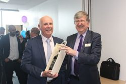 Mike Bird receives 20 year old port from Steve Walker